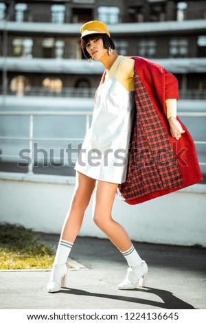 Fiatal szépség afroamerikai nő piros kabát Stock fotó © iordani