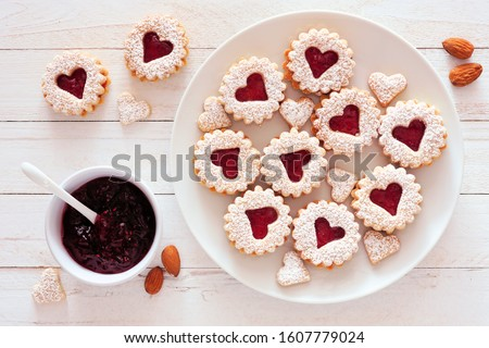 homemade heart shaped almond linzer cookies on white plate romantic set up red roses and candle lig stock photo © frimufilms