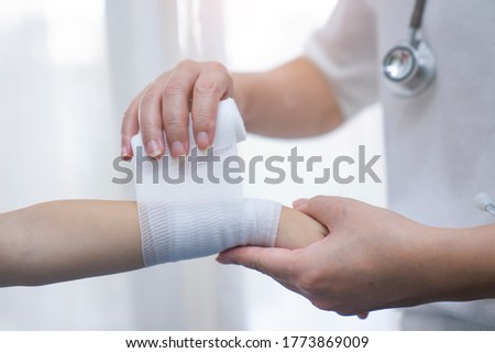 physiotherapist examining girl patients wrist with goniometer stock photo © wavebreak_media