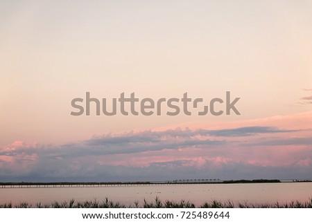 Landscape long bridge over a sea plait on a beautiful pink sunse Stock photo © TanaCh