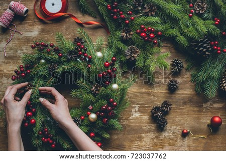 Cropped view of florist hands making Christmas wreath with fir b Stock photo © dashapetrenko
