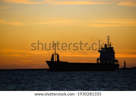 Beautiful sunset and a ship in the sea or ocean Stock photo © Nobilior
