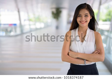 Young beautiful Asian businesswoman hanging out at the footbridg Stock photo © amazingmikael