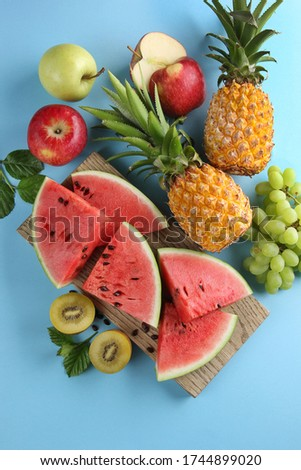 Pieces of a healthy pineapple on a blue background with space for text. Tropical fruit. Flat lay Stock photo © artjazz