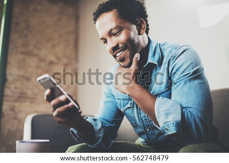 fiatal · üzletember · mobiltelefon · iroda · egyéb · emberek - stock fotó © boggy