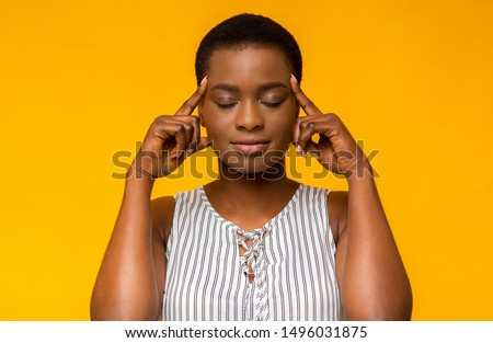 Portrait of a worried young casual girl holding fingers crossed Stock photo © deandrobot