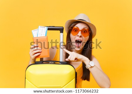 Isolated happy girl on an orange suitcase on a white background Stock photo © Imaagio