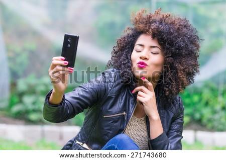 Fotó gyönyörű nő 20-as évek göndör haj elvesz mobiltelefon Stock fotó © deandrobot