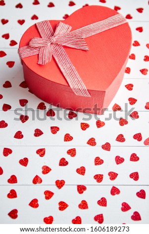 Vlentine's Day composition. Heart shaped sequins placed on white wooden table Stock photo © dash