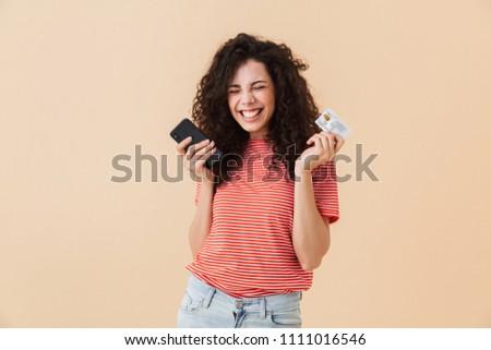 Fotó európai nő 20-as évek göndör haj tart Stock fotó © deandrobot