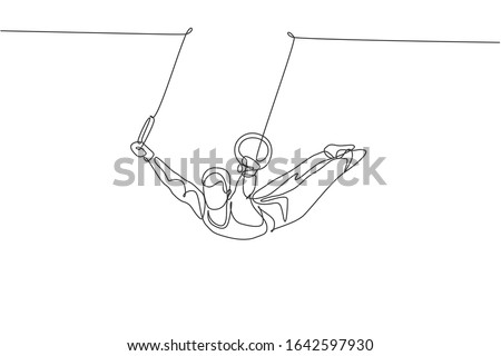 Fit young man exercising with gymnastic rings in a trendy fitness center  Stock photo © Kzenon
