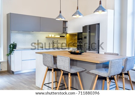 Stock photo: Kitchen facades with modern built-in kitchen appliances. Materials tiles in a trend color of the yea