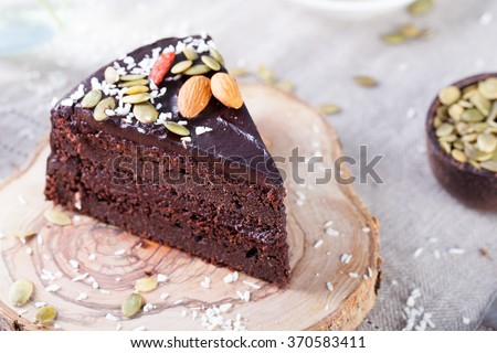 piece of dark chocolate cake decorated with chocolate bars on th stock photo © dashapetrenko