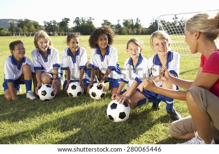 Group Of Kids Children In Soccer Team Having Training With Coach Stock photo © matimix