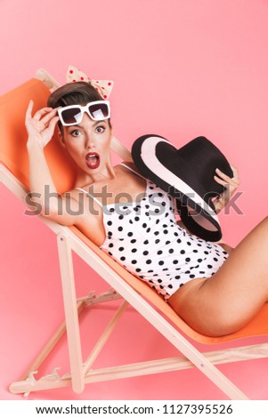 Woman in swimwear posing isolated over pink wall background. Stock photo © deandrobot
