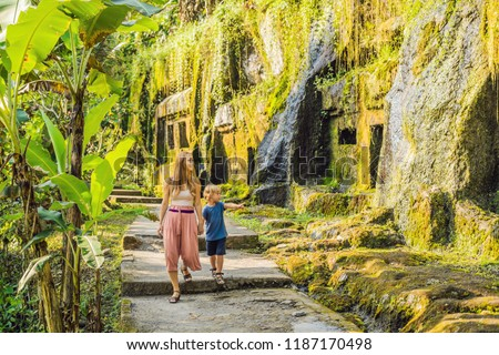 mom and son on background of gunung kawi ancient carved in the stone temple with royal tombs bali stock photo © galitskaya