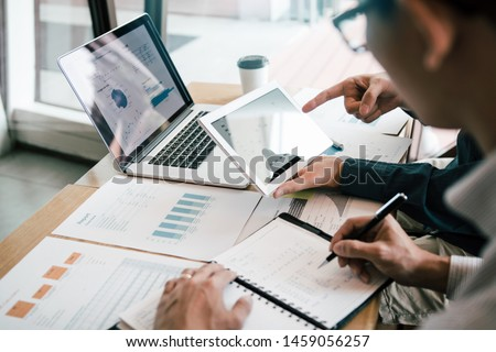 Business Colleagues Working Together With Data Analysis Paper Stock photo © AndreyPopov