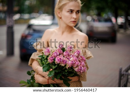 A fresh gently roses as a bouquet in a female hands on a white background with green leaf, copy spac Stock photo © artjazz