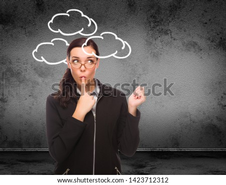 Clouds Drawn Around Head of Young Adult Woman In Front of Wall w Stock photo © feverpitch