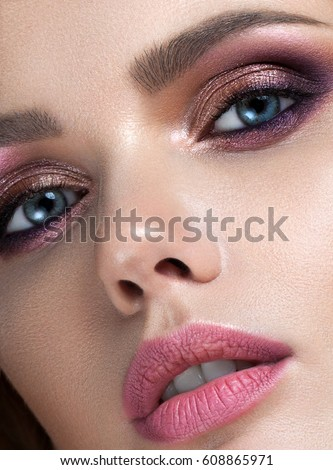 Beauty female face. Professional glossy lip makeup. Pink lip gloss and lipstick. Sensual female mout Stock photo © serdechny