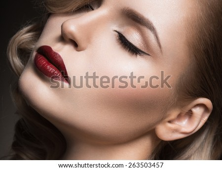 Beautiful face of the woman with ideal skin. Evening bright cosmetics. Eyelashes are long. Black and Stock photo © serdechny