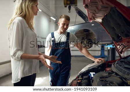 Young woman complaining to repairman or technician about drain in bathtub Stock photo © pressmaster