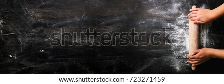 Raw dough for bread with ingredients on black background, male h Stock photo © Freedomz