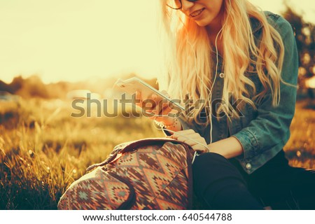 texting money. happy young hipster woman with hands up with laptop. Money coming up from laptop Stock photo © wavebreak_media
