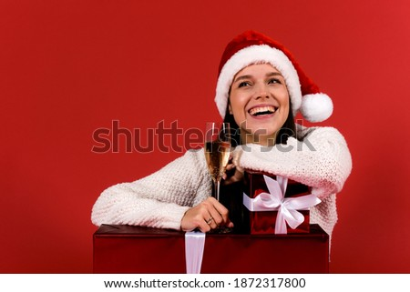 Smiling woman in the sweater with glass of champagne over lights Stock photo © dashapetrenko