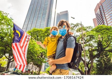 Apa fiú turisták Malajzia zászló felhőkarcolók Stock fotó © galitskaya