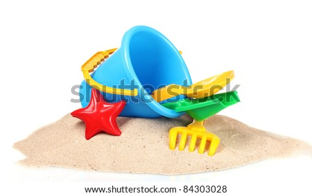 Kid playing on the beach with the children's shovel and a bucket Stock photo © galitskaya