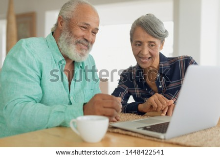Front view of an active  African American senior man using digital tablet while sitting on a sofa in Stock photo © wavebreak_media