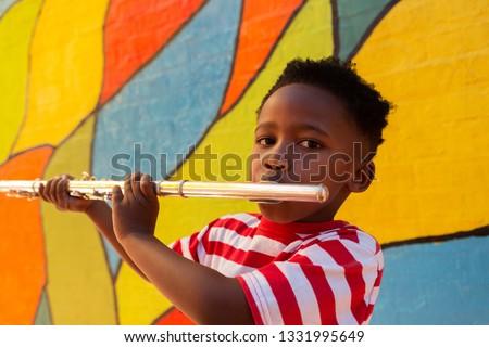 Ritratto african american scolaro giocare flauto strumento Foto d'archivio © wavebreak_media
