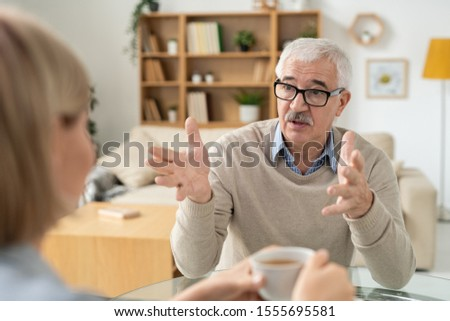 Retired man explaining something to his young daughter during discussion Stock photo © pressmaster