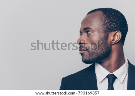 Side view of handsome young mixed-race businessman working on laptop standing in modern office Stock photo © wavebreak_media