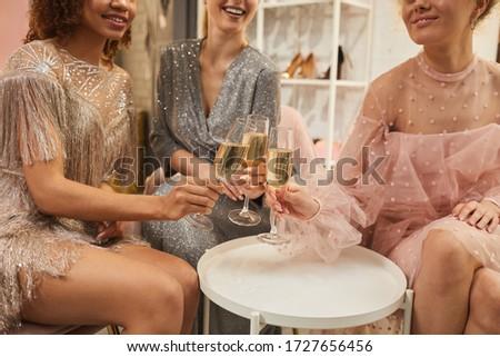 Fiatal mosolygó nő pompás ruha pirít furulya Stock fotó © pressmaster