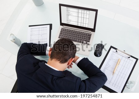 Tired Businessman Sleeping While Calculating Expenses In Office Stock photo © AndreyPopov
