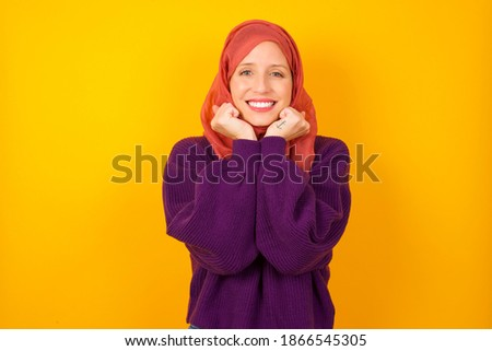 Image of happy dreamy woman keeps hands together, has eyes shut, smiles positively, has frizzy hair, Stock photo © vkstudio
