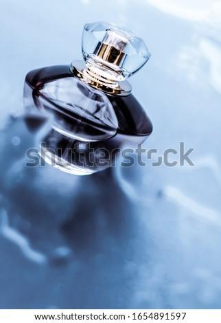 Stock photo: Perfume bottle under blue water, fresh sea coastal scent as glam