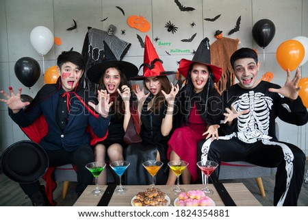 Portrait of happy three friends wear festive clothes, party hat, pose indoor against white backgroun Stock photo © vkstudio