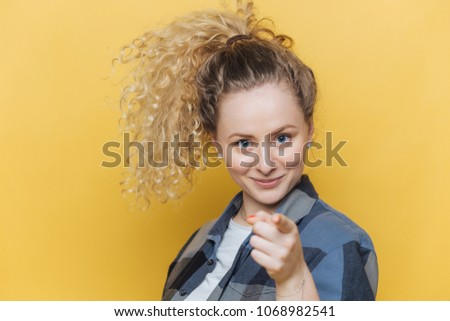 Positive confident beautiful female with curly pony tail, indicates directly at camera, chooses you, Stock photo © vkstudio