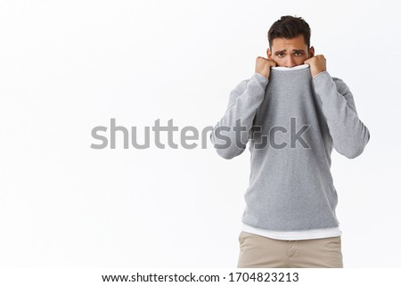 Sad gloomy cute masculine guy feeling offended or lonely, pointing left, sulking as looking camera d Stock photo © benzoix