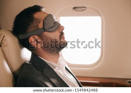 Man With Sleep Mask On Airplane Stock photo © AndreyPopov