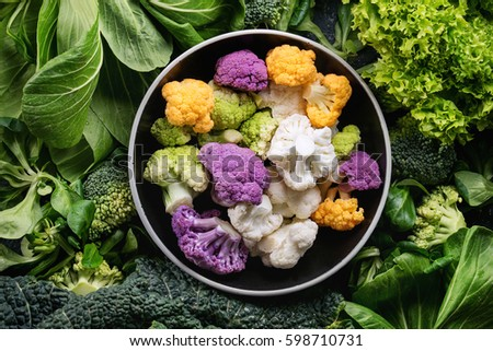 Top view of fresh vegetable salad with cauliflower, purple cabbage, chopped red bell pepper and cucu Stock photo © vkstudio