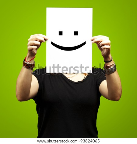 Person holding a paper with funny emoticon in front of her face Stock photo © ra2studio