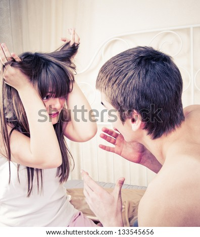 portrait of a man and woman yelling at each other against white stock photo © dacasdo
