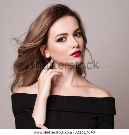 Fashion model with blond straight hair isolated on black backgro Stock photo © Victoria_Andreas