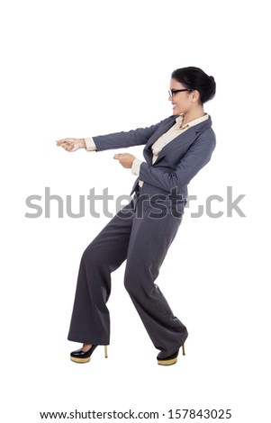 woman in a suit pulling something Stock photo © photography33