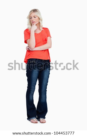 Young thoughtful woman standing upright against a white background Stock photo © wavebreak_media