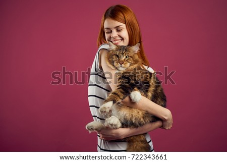young woman holding beautiful tabby cat with closed eyes relaxe stock photo © hasloo